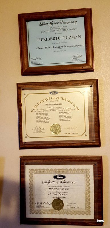 Photo of Eddie Guzman's graduation certificates.